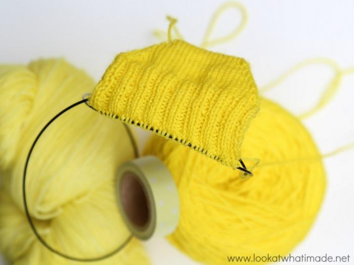 A crocheter knitting socks